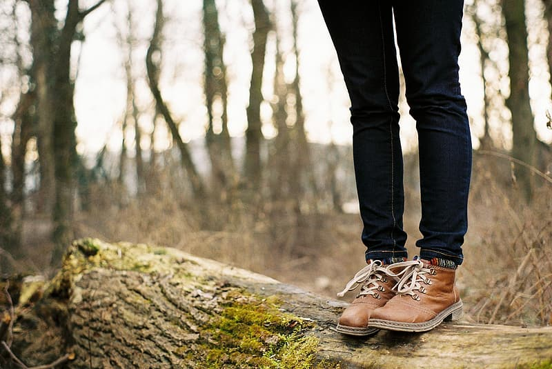 Photography of person wearing brown leather work boots during daytime