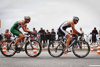 Two male cyclists on roadway