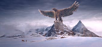 Brown eagle flying over snow covered mountain during daytime