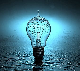 Water droplets on clear glass light bulb