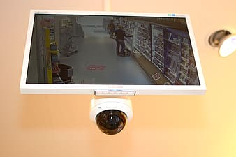 White Samsung flat screen CCTV monitor with turned-on screen