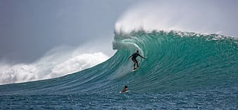 Portrait photography of person surfing on wave barrels