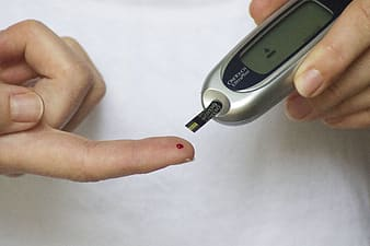Person taking blood on glocumeter