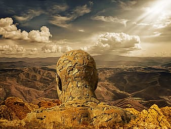 Close up photo of human head rock formation wallpaper