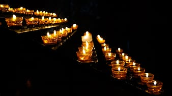 Low light photography of votive candles lighted up