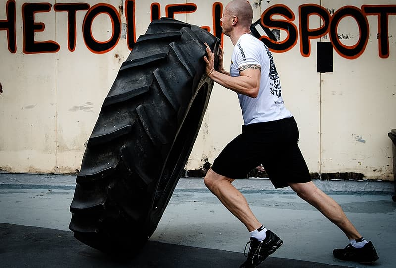 Man carrying vehicle tire