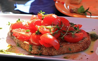 Friend meat with sliced tomatoes