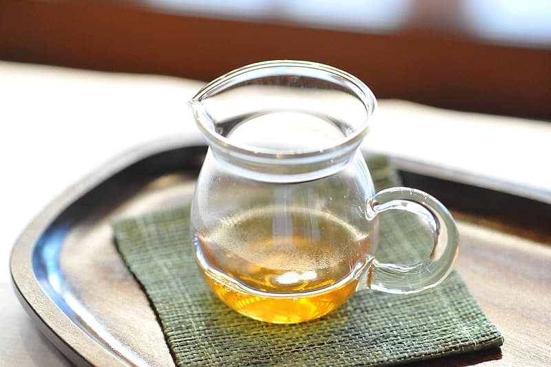 Clear glass pitcher on tray