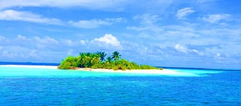 Islet between body of water at daytime