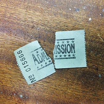 Admission ticket on beige surface