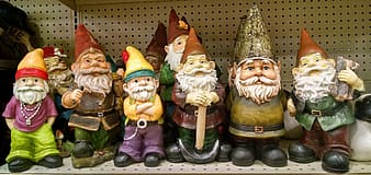 Assorted-color gnome figurine lot on brown perforated board
