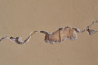 Cracked beige wall