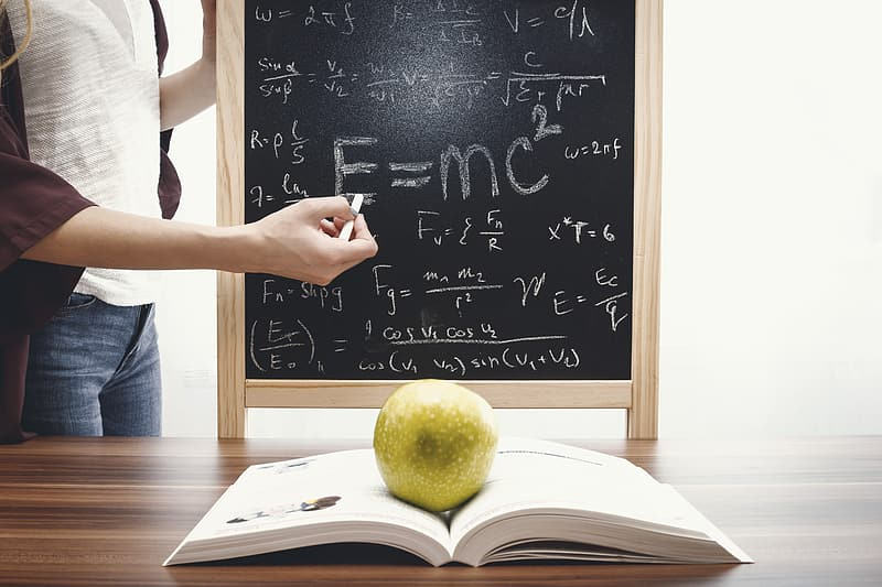 Teacher teaching and writes mathematical equations on the blackboard.  Education and School concept. | Pikrepo