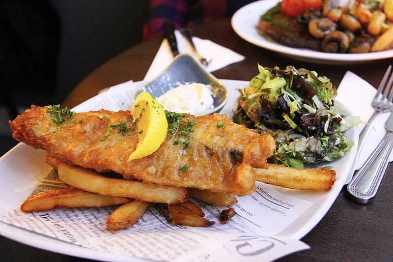 Fish fillet and fries on plate