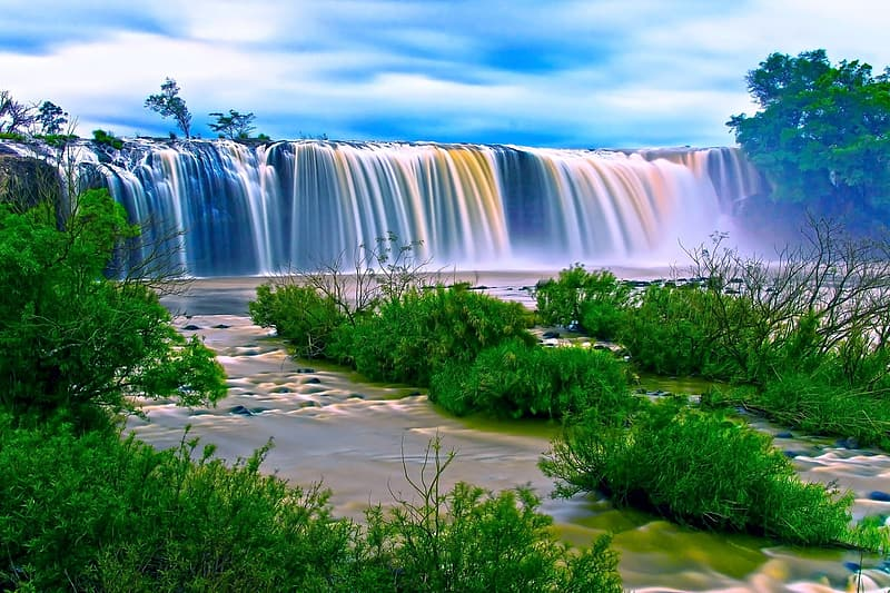 HD photography of waterfalls surrounded by green grasses and trees during daytime
