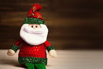 Selective focus photography of Santa Claus doll