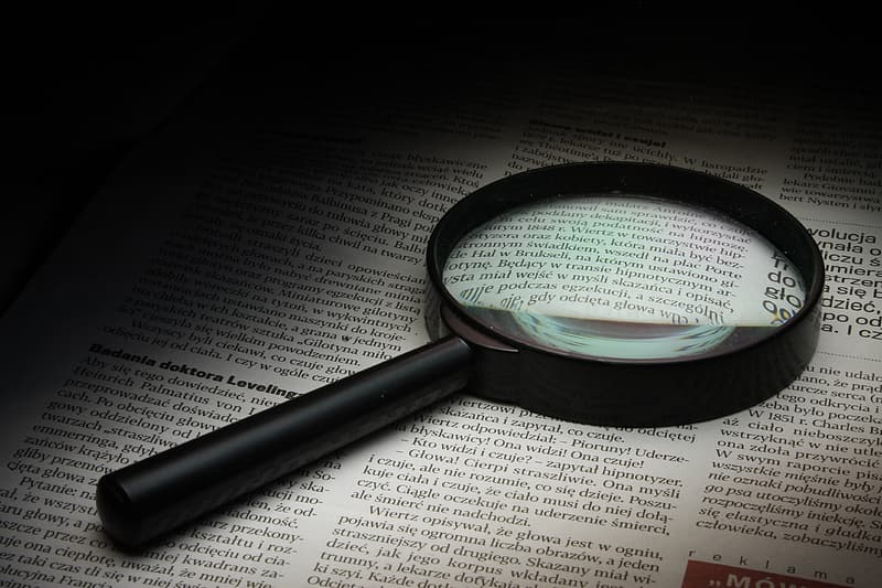 Magnifying glass on white paper