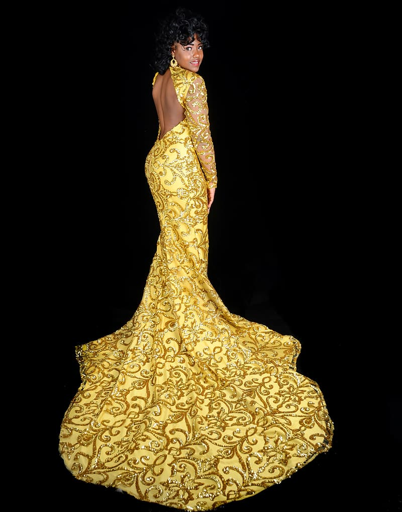 Photo of woman wearing yellow and black open back lace long-sleeved dress