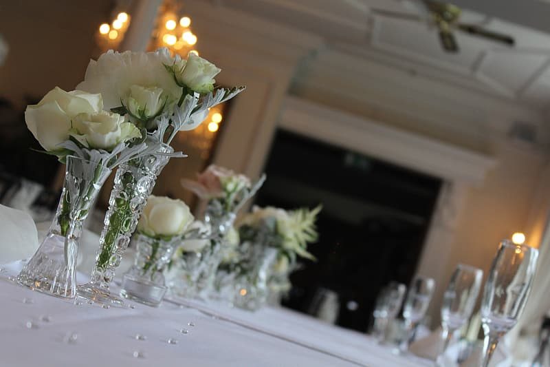 White roses centerpieces with lighted candles