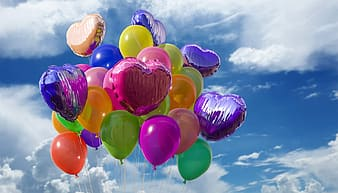 Assorted balloon under cloudy sky
