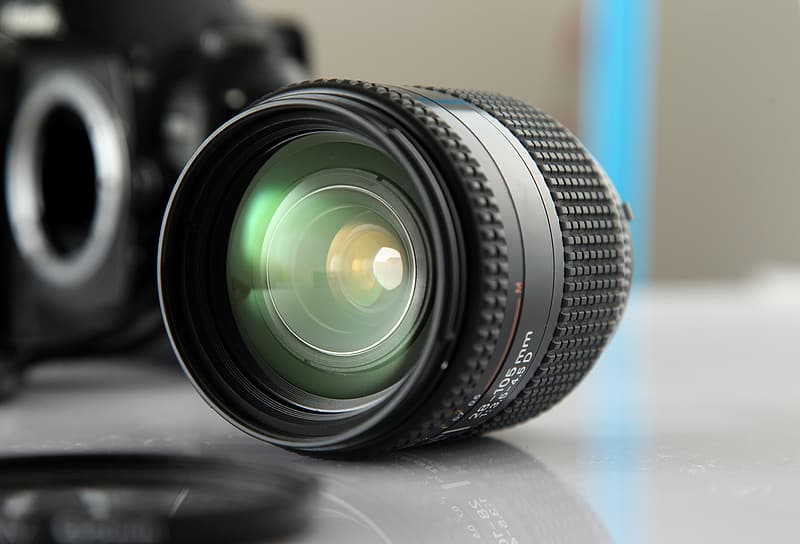 Black telephoto lens on gray surface