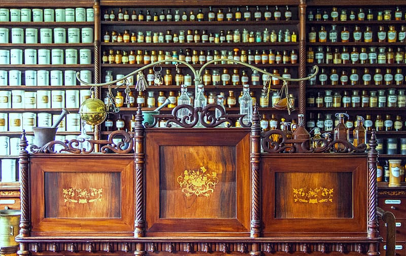 Brown wooden sideboard with assorted bottles