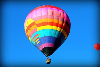 Flying multicolored hot air balloon
