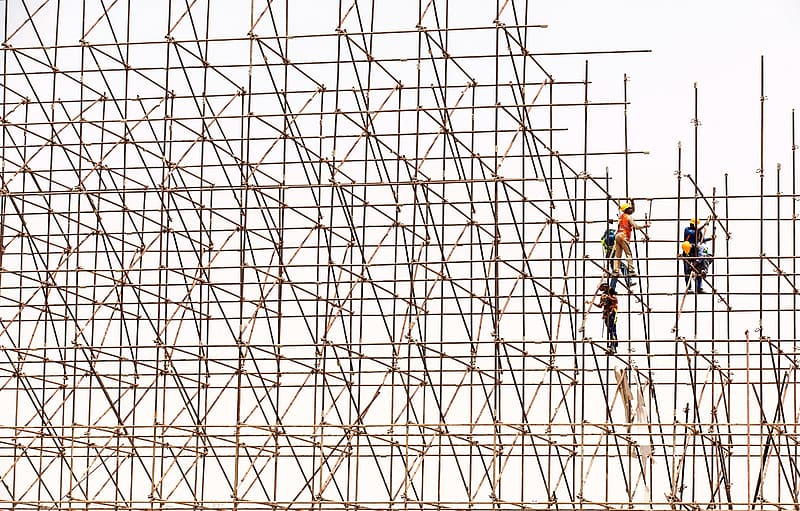 Several men on bamboo scaffolding