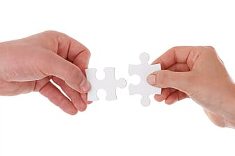 Person holding 2-pieces jig saw puzzle