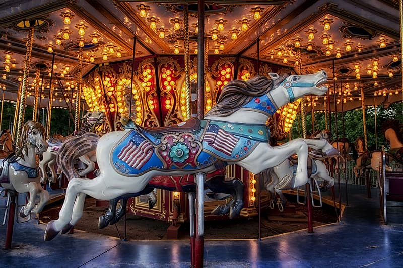 Gray and white horse carousel at daytime