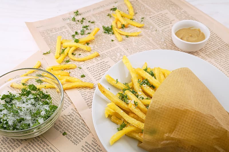 Plate of French fries with dipping sauce