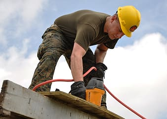 Person using power tool on the roof