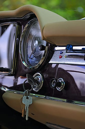Silver and gold car steering wheel