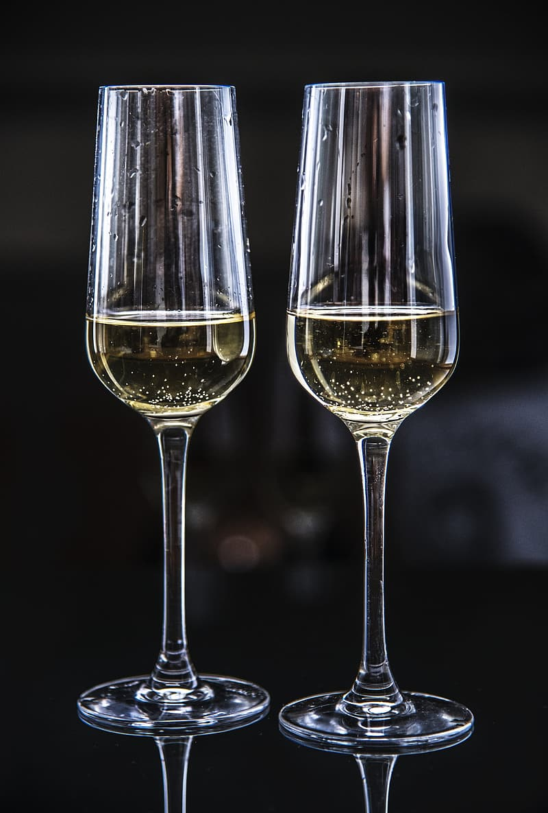 2 clear wine glasses with brown liquid