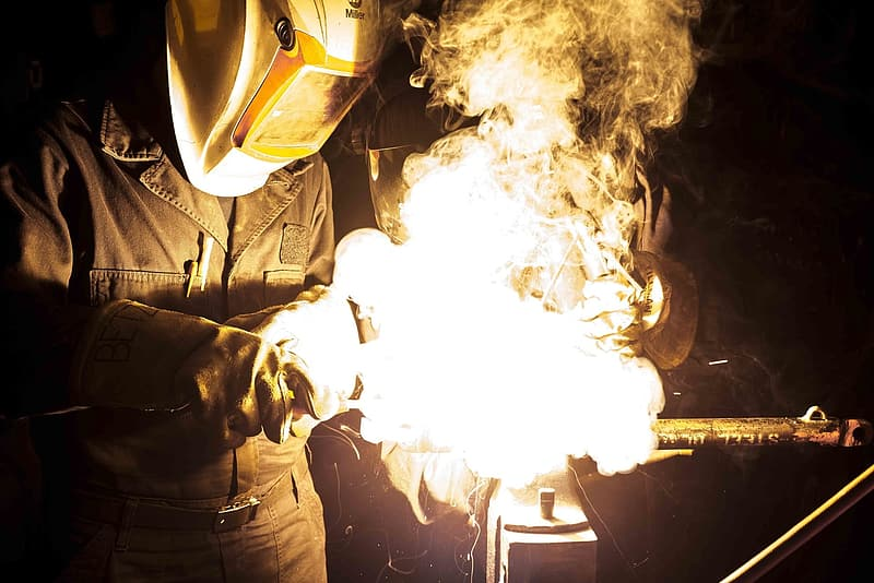 Person wearing mask while welding