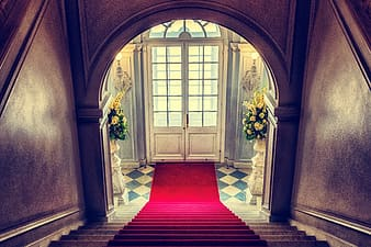 Red carpet on brown concrete hallway