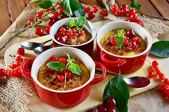 Baked food in three red ceramic two handled mugs