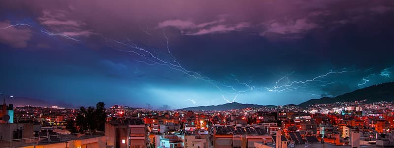 Aerial photography of buildings over lightning thunder sky