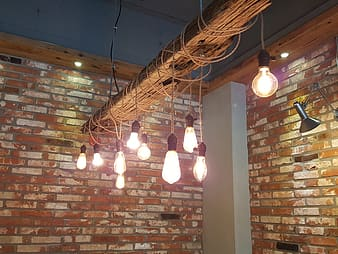 Brown pendant lamps turned on during daytime