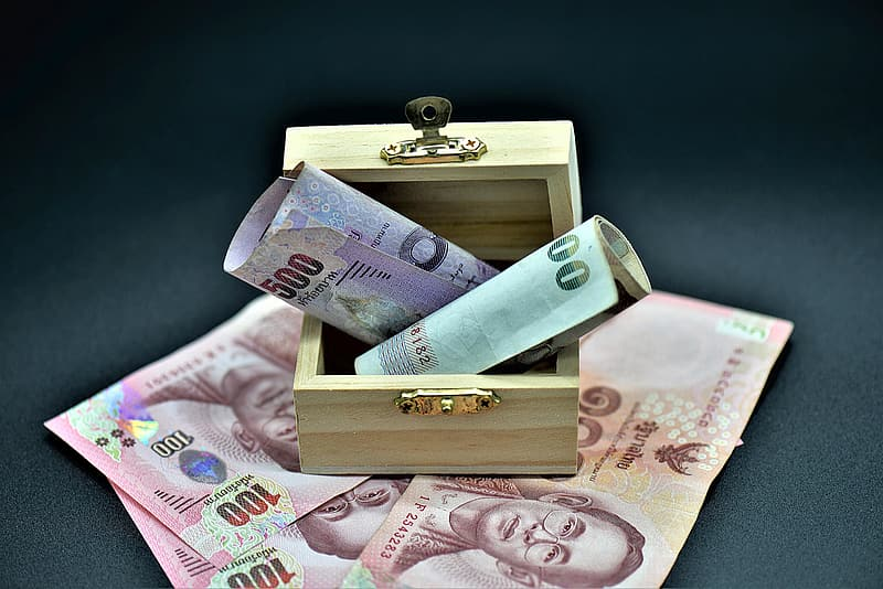 100 banknote on brown wooden box
