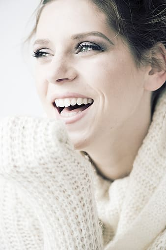 Woman wearing white sweater