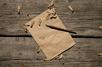 Brown paper on brown wooden table