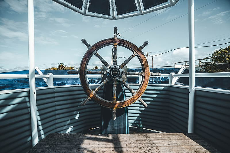 Brown wooden ship's wheel