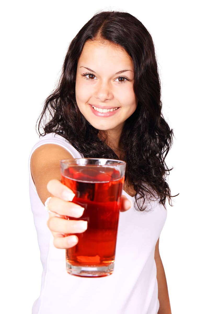 Woman holding clear drinking glass