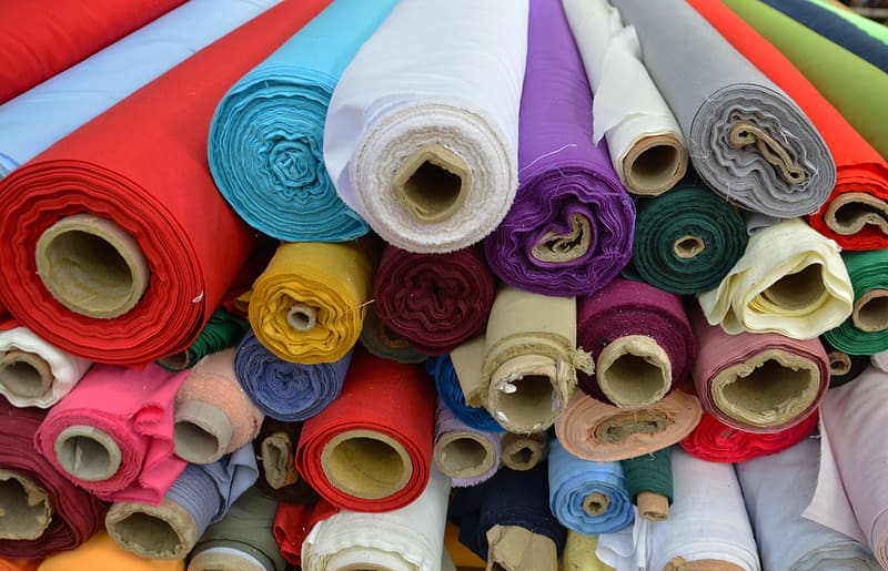 Assorted color rolled textiles