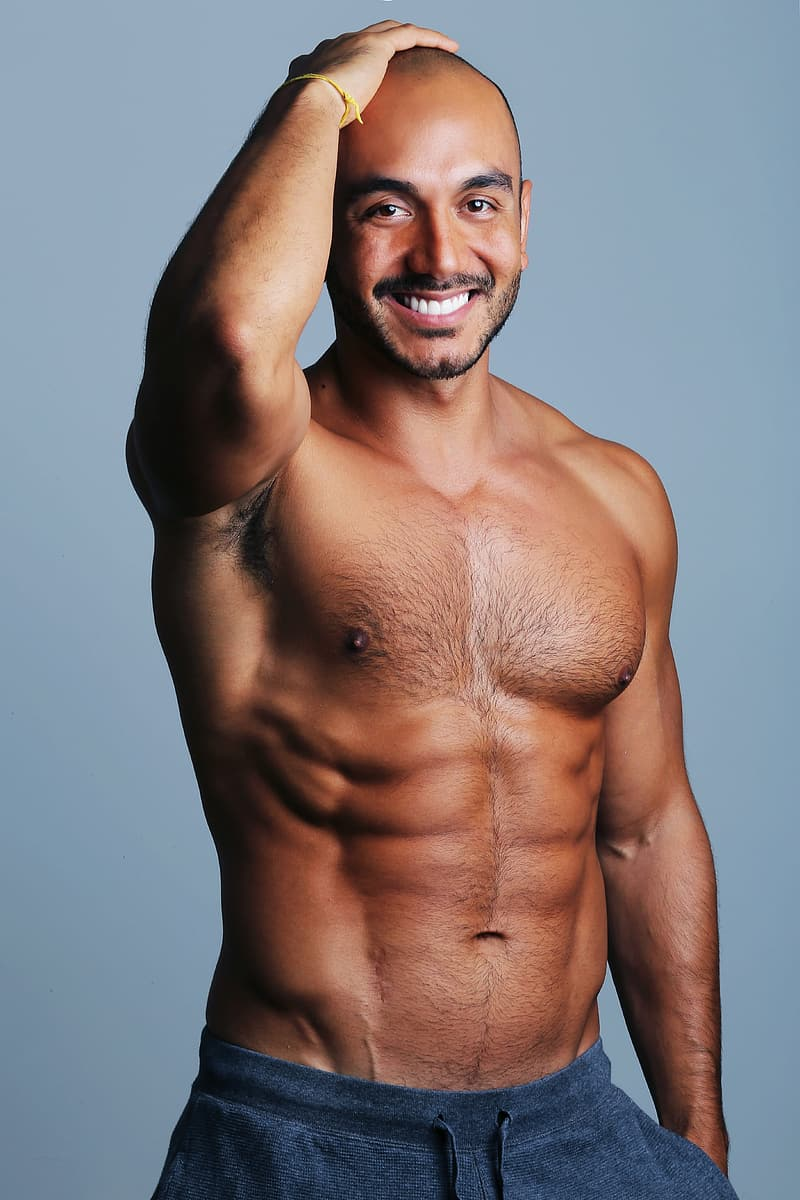 Topless man smiling and standing