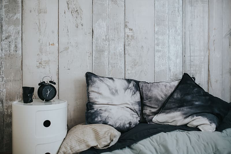 Collection of grey and white pillows