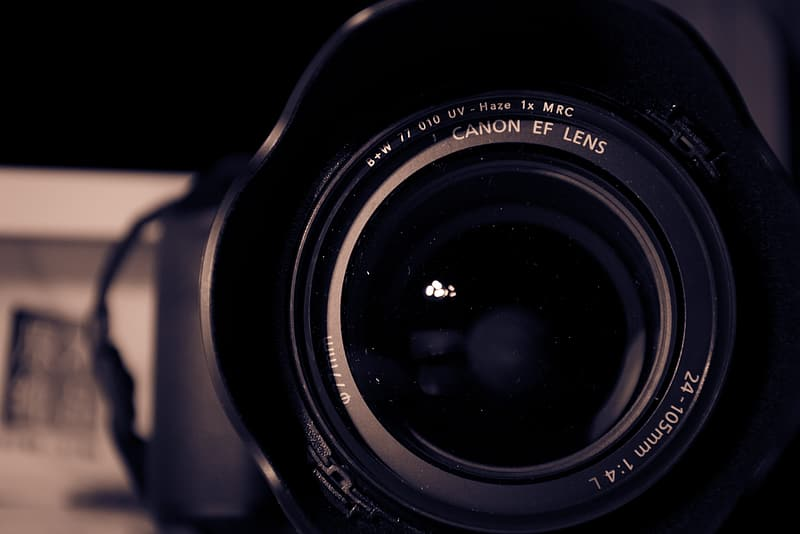 Black nikon camera lens in grayscale photography