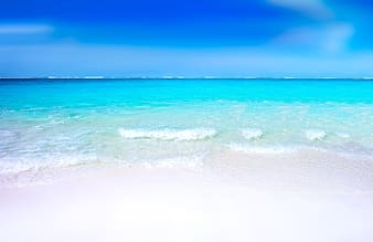 White sand beach during daytime