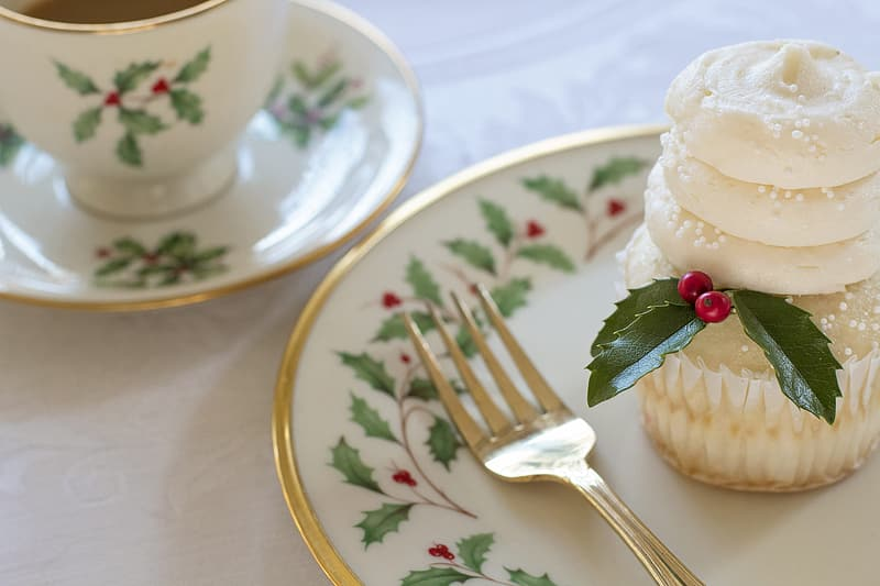 Icing cupcake with mistletoe on top